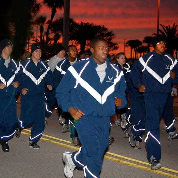 Young men running in track suits