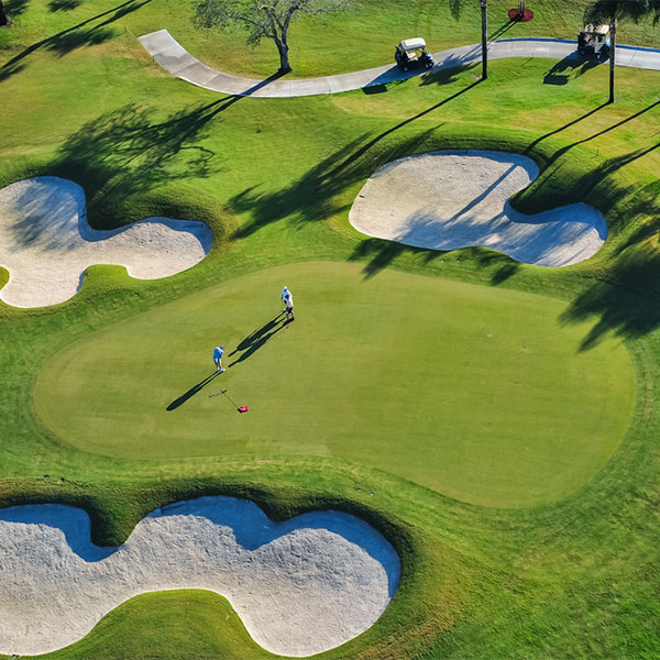 arial view of golf course with two people playing